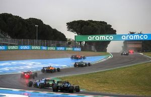 Carlos Sainz Jr., Ferrari SF21, runs wide ahead of Lance Stroll, Aston Martin AMR21, Lando Norris, McLaren MCL35M, Valtteri Bottas, Mercedes W12, and Fernando Alonso, Alpine A521, as Nicholas Latifi, Williams FW43B, spins