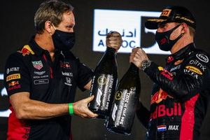 Paul Monaghan, Chief Engineer, Red Bull Racing, and Max Verstappen, Red Bull Racing, 1st positions on the podium with his champagne