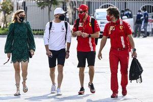Valtteri Bottas, Mercedes-AMG F1, and Sebastian Vettel, Ferrari, arrive