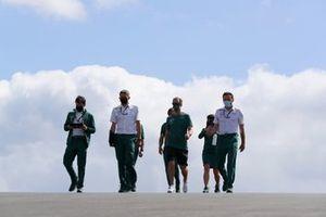 Sebastian Vettel, Aston Martin, walks the track with his engineers