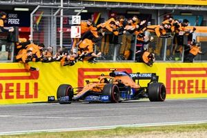Lando Norris, McLaren MCL35M crosses the finish line