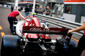 Car of Antonio Giovinazzi, Alfa Romeo Racing C38 being pushed down the pitlane by Alfa Romeo Racing mechanics