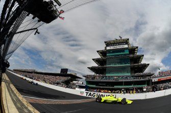 Simon Pagenaud, Team Penske Chevrolet crosses the finish line under the checkered flag for the win