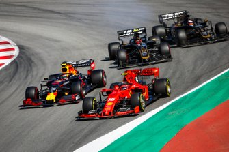 Charles Leclerc, Ferrari SF90, Pierre Gasly, Red Bull Racing RB15, Kevin Magnussen, Haas F1 Team VF-19 and Romain Grosjean, Haas F1 Team VF-19 battle
