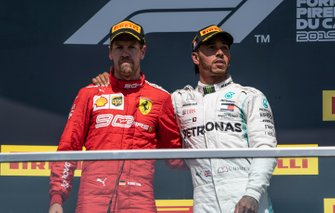 Sebastian Vettel, Ferrari, 2nd position, and Lewis Hamilton, Mercedes AMG F1, 1st position, on the podium