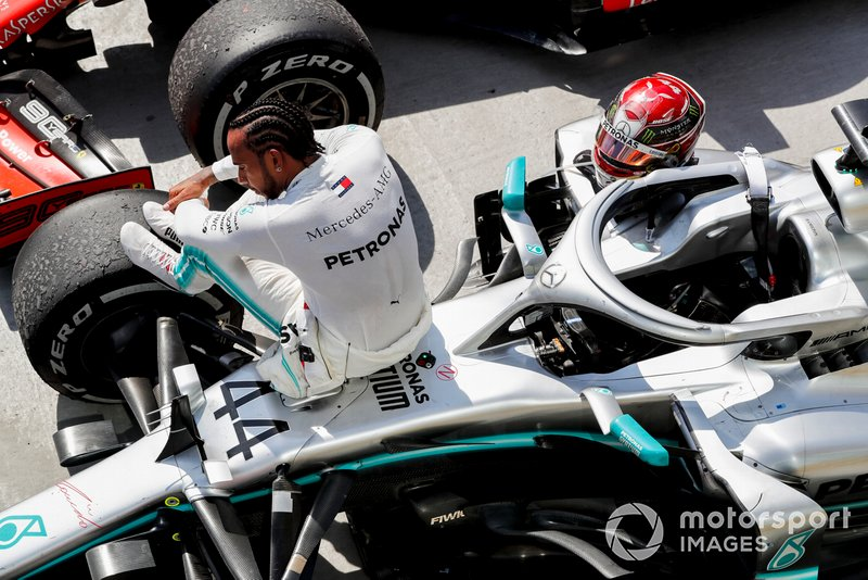 Lewis Hamilton, Mercedes AMG F1, 1st position, sits on his car in Parc Ferme
