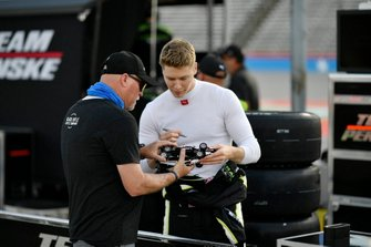 Josef Newgarden, Team Penske Chevrolet signs an autograph for a fan