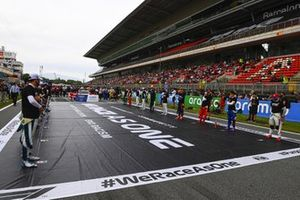 The drivers stand in support of the end racism campaign
