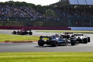 Carlos Sainz Jr., Ferrari SF21, Lando Norris, McLaren MCL35M, Yuki Tsunoda, AlphaTauri AT02, and Valtteri Bottas, Mercedes W12