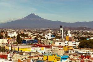 Puebla E-Prix Mexico with the Popocatepetl volcano in the distance.
