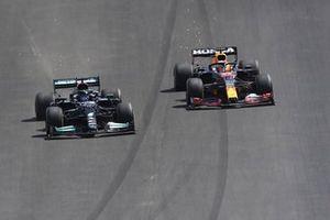 Lewis Hamilton, Mercedes W12, passes Max Verstappen, Red Bull Racing RB16B