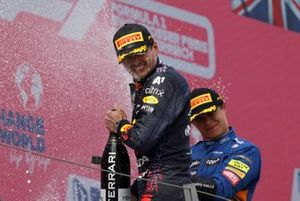 Max Verstappen, Red Bull Racing, 1st position, and Lando Norris, McLaren, 3rd position, celebrate with Champagne