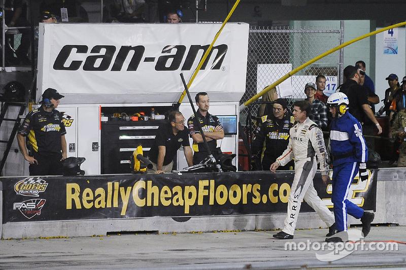 Carl Edwards, Joe Gibbs Racing Toyota walks down pit road after crashing
