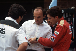 Ayrton Senna, discusses his first run in the Williams FW08C with team owner Frank Williams and Allan Challis Williams Team Manager
