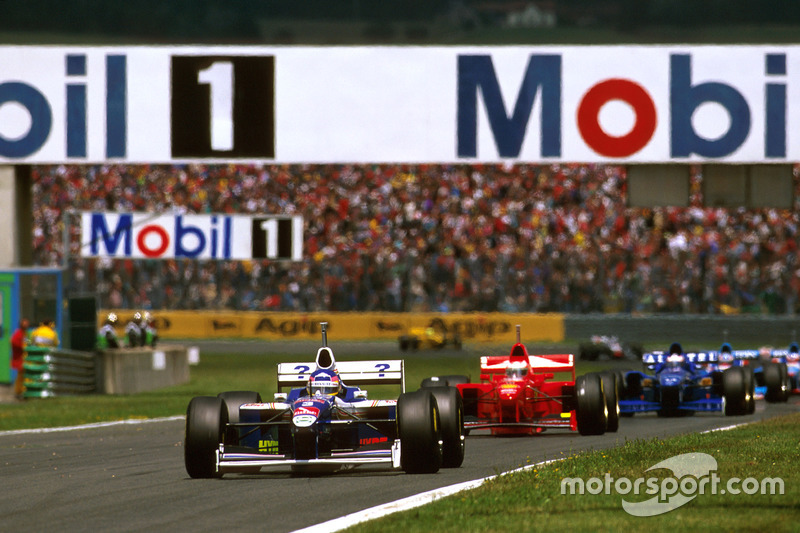 Jacques Villeneuve, Williams FW19 Renault leads Michael Schumacher, Ferrari F310B and Olivier Panis,