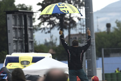 Rossi fan standing on the tyre wall celebrating Lorenzo's crash