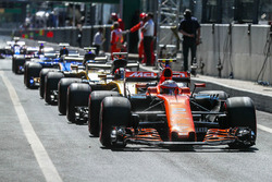 Cars line up in the pitlane