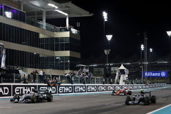 Race winner Lewis Hamilton, Mercedes AMG F1 W07 Hybrid takes the chequered flag at the end of the race with second placed team mate and World Champion Nico Rosberg, Mercedes AMG F1 W07 Hybrid