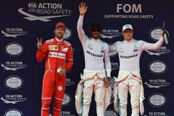 Sebastian Vettel, Ferrari, pole sitter Lewis Hamilton, Mercedes AMG F1 and Valtteri Bottas, Mercedes AMG F1 celebrate in parc ferme