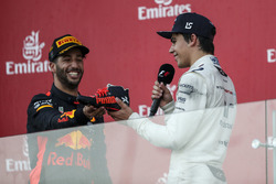 Lance Stroll, Williams celebrates on the podium, Daniel Ricciardo, Red Bull Racing and does a shoey, the champagne