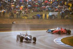 Jacques Villeneuve, Williams FW18 Renault leads Michael Schumacher, Ferrari F310 and Jean Alesi, Ben