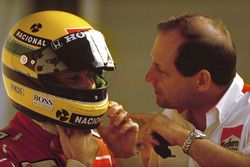 Ayrton Senna, McLaren Honda, prepares to qualify under the watchful eye of McLaren team boss Ron Den