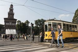 Carlos Sainz Jr. and Daniil Kvyat walk close to the Castello Sforzesco
