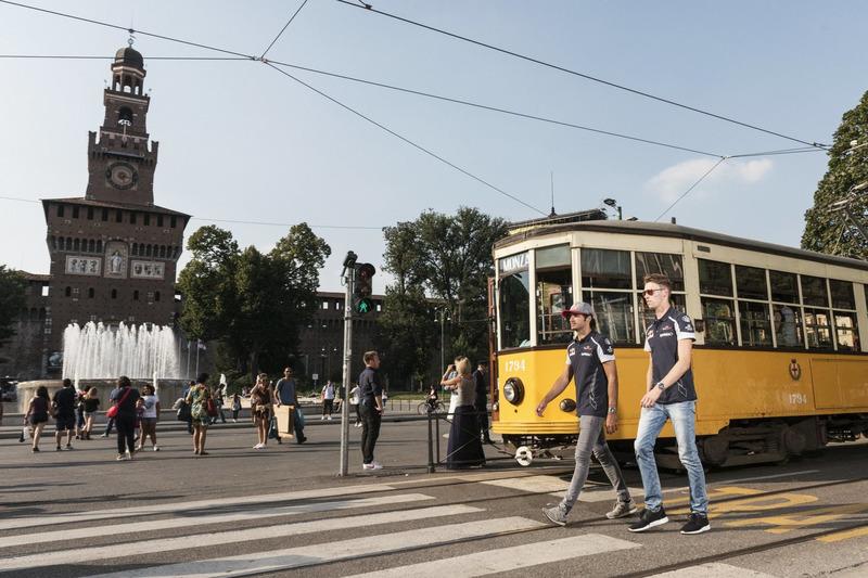 Carlos Sainz Jr. and Daniil Kvjat walk close to the Castello Sforzesco