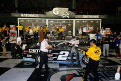 Race winner Brad Keselowski, Team Penske Ford celebrating with Roger Penske