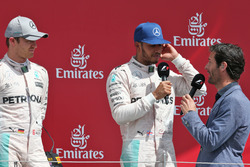 The podium (L to R): Nico Rosberg, Mercedes AMG F1 with race winner Lewis Hamilton, Mercedes AMG F1 and Mark Webber, Porsche Team WEC Driver / Channel 4 Presenter