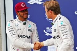 (L to R): Lewis Hamilton, Mercedes AMG F1 celebrates his pole position with third placed team mate N