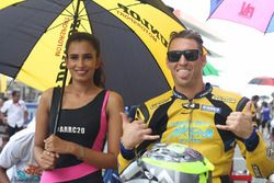 Anthony West with a hot grid girl