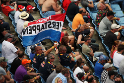 Max Verstappen, Red Bull Racing fans and flag in the grandstand