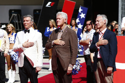 Michael Buffer and former US President Bill Clinton stand for the national anthem