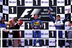 The podium finishers, Flavio Briatore, Benetton Team Principal, Prince Michael of Kent, Jean Alesi, Ferrari 2nd, Johnny Herbert, Benetton 1st, David Coulthard, Williams 3rd, Kenneth Clarke, MP