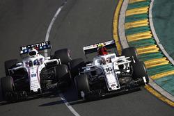 Charles Leclerc, Sauber C37 Ferrari, battles with Lance Stroll, Williams FW41 Mercedes