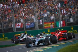 Lewis Hamilton, Mercedes AMG F1 W09, leads Kimi Raikkonen, Ferrari SF71H, Sebastian Vettel, Ferrari