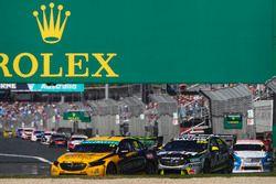 Tim Slade, Brad Jones Racing Holden, leads Craig Lowndes, Triple Eight Race Engineering Holden, and