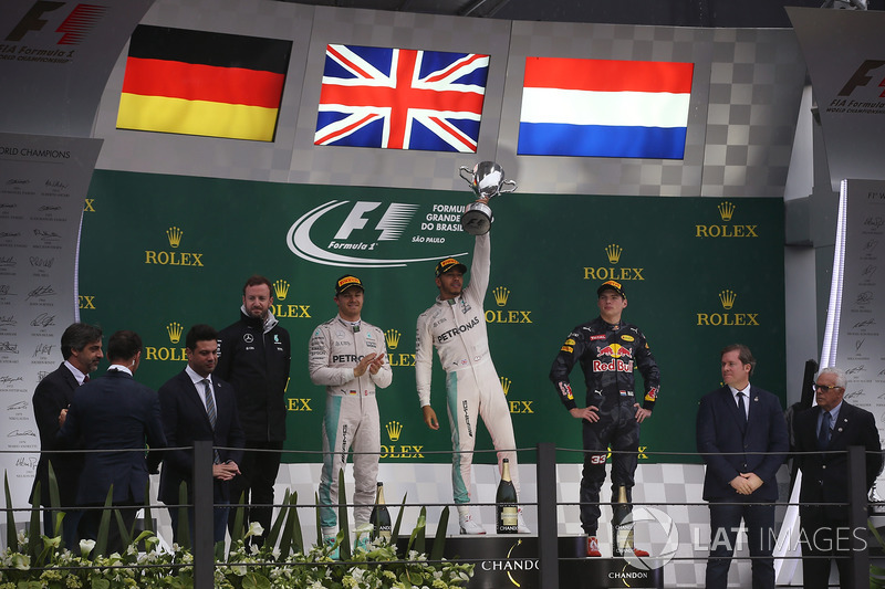 Lewis Hamilton, Mercedes AMG, celebrates victory on the podium alongside Nico Rosberg, Mercedes F1 W