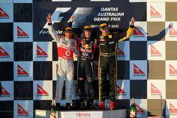 Podium: second place Lewis Hamilton, McLaren, Race winner Sebastian Vettel, Red Bull Racing, third place Vitaly Petrov, Lotus F1 Team