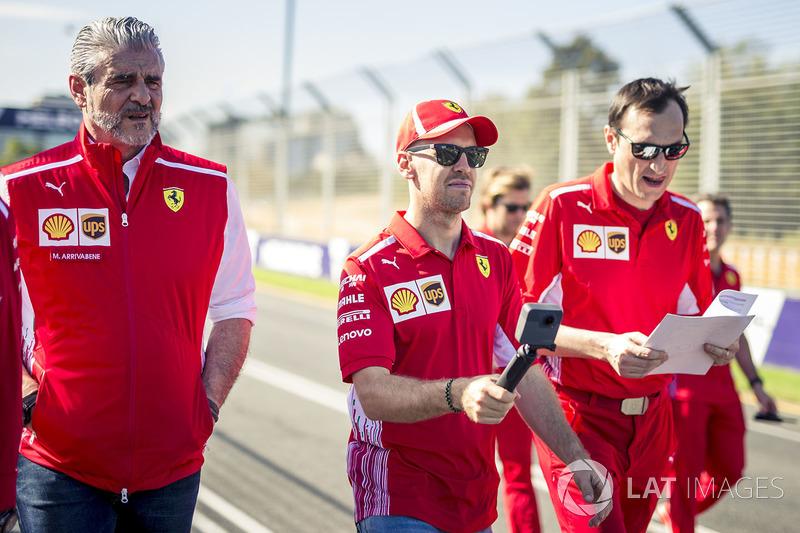Sebastian Vettel, Ferrari walks the track with Maurizio Arrivabene, Ferrari Team Principal and Riccardo Adami, Ferrari Race Engineer