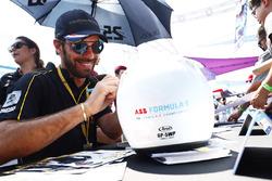 Jean-Eric Vergne, Techeetah, signs a helmet Sam Bloxham
