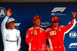Top three qualifiers Valtteri Bottas, Mercedes AMG F1, pole sitter Sebastian Vettel, Ferrari, and Kimi Raikkonen, Ferrari