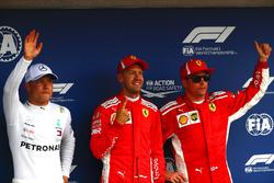 Le deuxième, Valtteri Bottas, Mercedes AMG F1, le poleman Sebastian Vettel, Ferrari, et le troisième, Kimi Raikkonen, Ferrari
