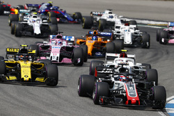 Romain Grosjean, Haas F1 Team VF-18, leads Carlos Sainz Jr., Renault Sport F1 Team R.S. 18, Charles Leclerc, Sauber C37, Sergio Perez, Force India VJM11, and Fernando Alonso, McLaren MCL33