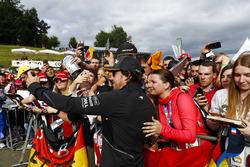 Fernando Alonso, McLaren, has his picture taken for a fan
