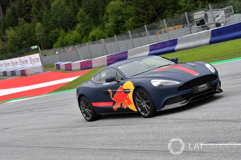 Max Verstappen, Red Bull Racing in an Aston Martin