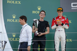 ART Grand Prix team member collects the trophy.