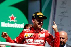 Race winner Sebastian Vettel, Ferrari after winning the race