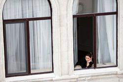 A fan watches from her window